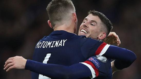 Ryan Christie congratulates Scott McTominay on scoring the winning goal.(Getty)