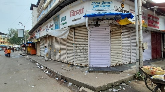 Shops are closed at Station Road in Thane as the state observes complete shutdown.