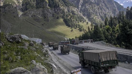 In this file photo, an Indian army convoy moves on the Srinagar-Ladakh highway at Gagangeer, northeast of Srinagar, Jammu and Kashmir. Indian and Chinese army commanders met on Sunday to discuss steps to disengage troops from key friction areas along their disputed border to ease a 17-month standoff. (AP)