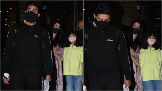 For their flight to Mumbai, the family of three were dress in comfortable ensembles and served airport fashion goals. While Abhishek and Aaradhya chose comfy fits, Aishwarya opted for a more chic attire.(HT Photo/Varinder Chawla)