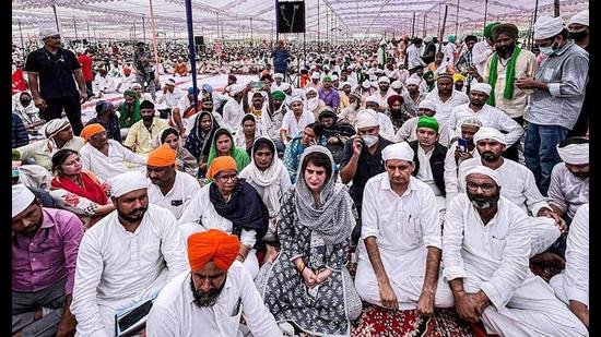 Congress leader Priyanka Gandhi Vadra, MP Deepender Hooda and UPCC chief Ajay Kumar Lallu with others attend the 'Antim Ardas' of farmers who were killed in Lakhimpur Kheri incident, at Tikunia in Lakhimpur Kheri on Tuesday, (PTI Photo)