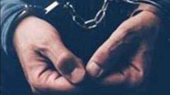 Arrested computer hacker and cyber criminal with handcuffs, close up of hands (Getty Images/iStockphoto)