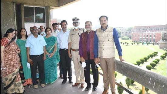 UT adviser Dharam Pal (right) on a visit to Panjab University on Tuesday. (HT PHOTO)
