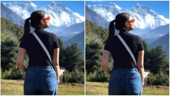 """Dressed in a black tee-shirt and a pair of blue denims, Parineeti posed with her back to the camera, where she can be seen staring in awe at the mountains peaks in front of her. """"You gave me a lesson in humility today,"""" she added.(Instagram/@parineetichopra)"""