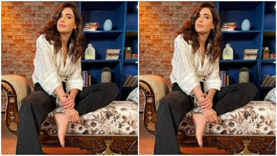 The cotton shirt, folded at the elbows, hugs the actor's midriff perfectly and sets casual fashion goals higher. The black trousers are loose at the ends and are visibly comfy.(Instagram/@karishmaktanna)