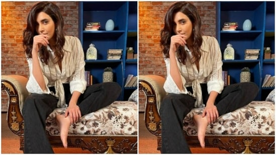 """Karishma shared her """"state of mind"""" with the slew of pictures. The actor is in a shirt and trousers state of mind and it reflects in her fashionable attire.(Instagram/@karishmaktanna)"""