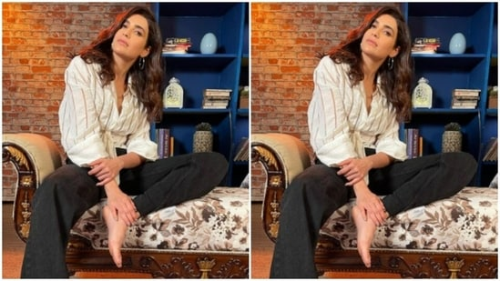 The actor left her shoulder-length tresses open with a side part, in soft wavy curls around her shoulder. The indoor backdrop perfectly sets the mood in Karishma's pictures.(Instagram/@karishmaktanna)