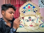 An artist named Biswajeet Nayak makes Maa Durga's face using a total of 275 ice cream sticks on the occasion of Maha Ashtami, in Puri.(ANI)