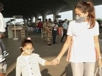 Shahid Kapoor and Mira Rajput were snapped at the Mumbai airport on Wednesday morning with their kids, daughter Misha and son Zain. The family of four arrived at the airport to catch their flight out of Mumbai looking nothing short of effortless and comfy, setting airport fashion goals for us.(HT Photo/Varinder Chawla)