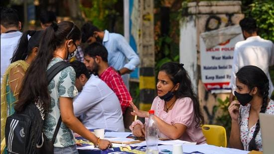 New Delhi, India - Oct. 5, 2021: Students seen at a help desk at Delhi University's north campus on the second day of admissions for 2021-22, in New Delhi , India, on Tuesday, October 5, 2021. (Photo by Amal KS / Hindustan Times) (Hindustan Times)