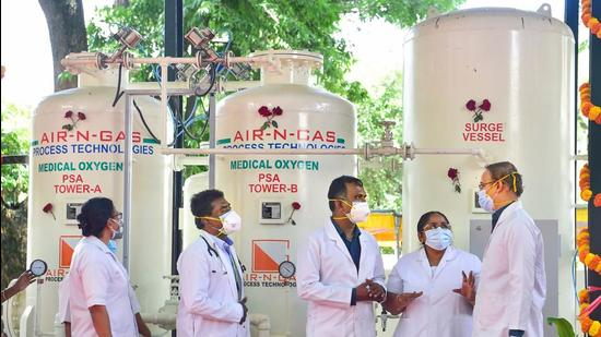Medics at a newly inaugurated PM CARES funded PSA oxygen plant in Bengaluru on October 7. At present, 1,183 PSA oxygen plants are operational. (PTI)