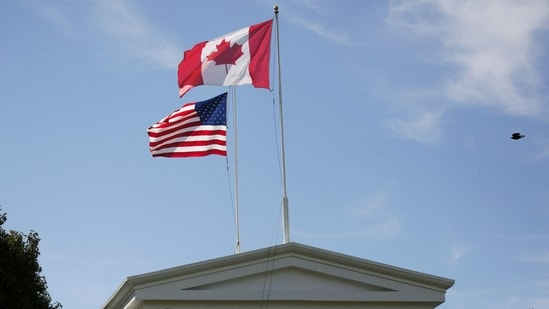 US to lift Canada, Mexico land border curbs in November for vaccinated tourists.(Photo by Jason Redmond / AFP)