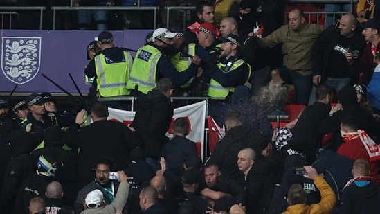 Fans of Hungary clash with police during the 2022 FIFA World Cup Qualifier match.(Getty)