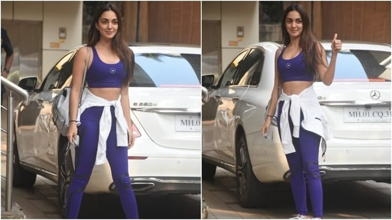 Kiara carried a pastel blue backpack with her outfit.  Chunky lace-up sneakers and open locks surround her OOTD.  She flaunted her bare skin with the outfit and looked chic.  (HT Photo/Varinder Chawla)