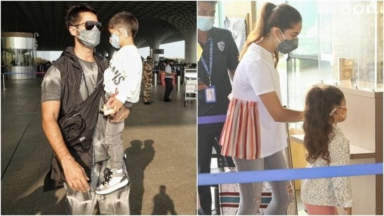 Shahid and Mira arrived at the Mumbai airport today with their two kids.  Shahid holds his son Zain in his arms and Misha holds his mother Meera's hand while entering the airport.  (HT Photo/Varinder Chawla)