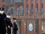 Security personnel keep watch outside Wuhan Institute of Virology during the visit by the World Health Organization (WHO) team tasked with investigating the origins of the coronavirus disease (Covid-19), inWuhan, Hubei province, China(REUTERS/Thomas Peter/File Photo)