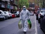 A man wearing a protective suit is seen on a street in Wuhan, Hubei province, the epicentre of China's coronavirus disease.(Reuters Photo)
