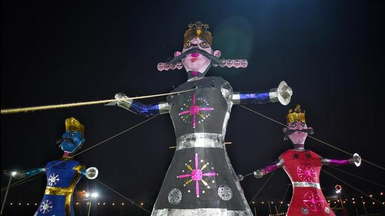 On Dussehra, effigies of Ravana, Meghnad and Kumbhkarna are burnt in public spaces as a symbolic gesture to mark the victory of good over evil. The annual festival is celebrated across the city – in open grounds, marketplaces and parks. (Sanchit Khanna/HT Photo)