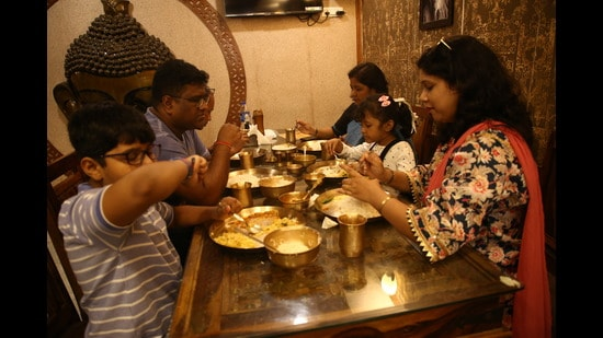 Foodies from all over Delhi-NCR are trying authentic Bengali dishes in CR Park, as food stalls and bhog at Durga Puja pandals remain subjected to COVID restrictions this year as well. (Photo: Raajessh Kashyap/HT)