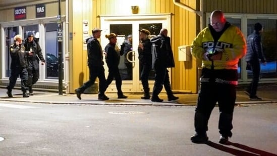 Police work at the scene where an arrow was shot into a wall in Kongsberg, Norway, Wednesday, Oct. 13, 2021. A man armed with a bow and arrows killed several people Wednesday near the Norwegian capital of Oslo before he was arrested, authorities said.(AP)