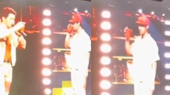 Nick Jonas and Joe Jonas at the Jonas Brothers concert.