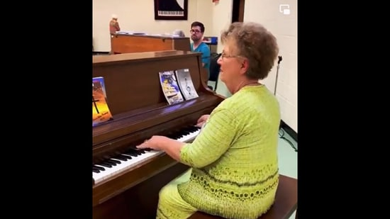 Woman plays a beautiful tune on piano with full gusto. Screengrab