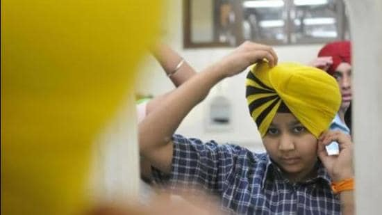 After a few minutes of hopeful patience, we called him to discover that he was still tying his 'pagg'. Parents with young turbanators at home must have guessed that our movie plan was running into rough weather. (Representative photo)