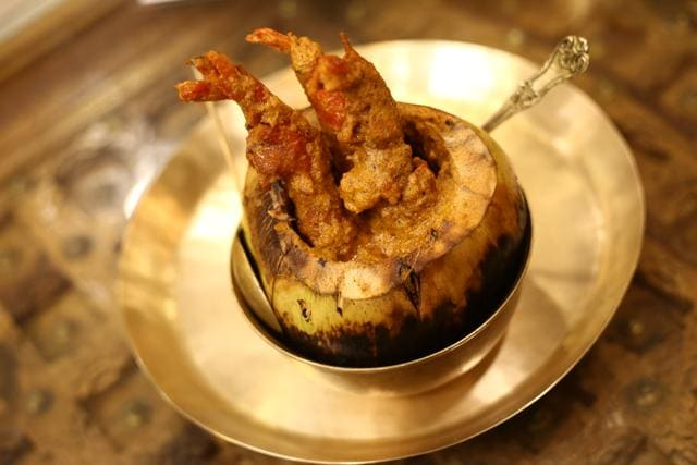 Dab chingri is a traditional Bengali dish cooked with chingri (prawns) and served in tender coconut.  (Photo: Rajesh Kashyap/HT)