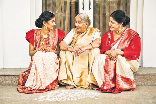 The girls learn making alpana from thakuma who can draw the most incarnate patterns on the floor even with her eyes shut. Shavitri Ghosh shares wears off white katan silk with gold zari jaal brocade all over. The saree has gold zari border and heavy brocade pallu. (Photo: Akhil Verma)