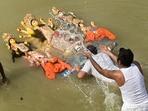 Vijayadashami marks the final day of the Durga Puja festival. On this day devotees bid goodbye to Goddess Durga by immersing the idols in water. In the North, devotees burn effigies of Ravan, Meghnad and Kumbhakaran. Here's how the people of Kolkata celebrated Vijayadashami.(PTI)