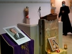 An image of murdered British Conservative lawmaker David Amess is displayed near the altar in St Peters Catholic Church before a vigil in Leigh-on-Sea on Friday.(AP Photo)
