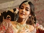 Ananya Panday, in red and gold, slays bridal fashion goals(Instagram/@ananyapanday)