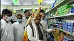 Khattar inaugurated the first Har Hith grocery store in Farrukhnagar and also became the first customer to buy goods from such a store. (Parveen Kumar/HT Photo)