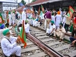 Members of various farmers organizations block railway tracks during the 'rail roko' protest against the central government in Patiala.(PTI)