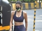 Malaika Arora's gym diaries are goals for us for multiple reasons. They manage to make us drool with the actor's fitness, and also the stunning athleisure that she adorns every day. Malaika is often spotted stepping out of her home in Mumbai, looking just too fashionable. On Tuesday, she was clicked by paparazzi in yet another sassy athleisure.(HT Photos/Varinder Chawla)