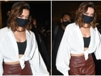 Deepika Padukone took a flight out of Mumbai today, and for her airport look, she made a head-turning style statement in one of her most chic ensembles. The star gave an elegant take to her jet-set outfit and left the internet swooning.(HT Photo/Varinder Chawla)