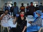 Students get their vaccine jabs at Dnyanasadhana College in Maharashtra's Thane.(Praful Gangurde/HT Photo)