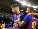 Barcelona's Gerard Pique, right, celebrates with his teammate Memphis Depay after scoring his side's first goal during a Champions League group E soccer match between F.C. Barcelona and Dinamo Kyiv at Camp Nou stadium in Barcelona, Spain, Wednesday, Oct. 20, 2021. (AP Photo/Joan Monfort)(AP)