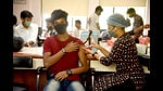 College students get their vaccination in a special drive for colleges by Navi Mumbai Municipal Corporation in Vashi on Friday. (BACHCHAN KUMAR/HT PHOTO)
