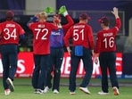 England's Tymal Mills, (72), celebrates after taking the wicket of West Indies' Nicholas Pooran caught out by England's Jos Buttler during the Cricket T20 World Cup match between England and the West Indies at the Dubai International Cricket Stadium, in Dubai, UAE, Saturday, Oct. 23, 2021(AP)