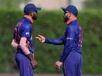 India's captain Virat Kohli, right, talks with teammate Hardik Pandya during the Cricket Twenty20 World Cup(AP)
