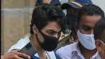File photo: Aryan Khan, son of Bollywood actor Shah Rukh Khan, is escorted to court by Narcotics Control Bureau (NCB) officials for a bail plea hearing. (AFP)