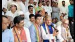 Senior Congress leader Pramod Tiwari addressing a press conference in Varanasi ahead of Pratigya Yatra. (HT photo)