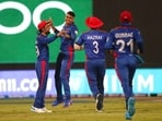 Afghanistan's Mujeeb Ur Rahman, third right, celebrates the wicket of Scotland's captain Kyle Coetzer during the Cricket Twenty20 World Cup match between Afghanistan and Scotland in Sharjah, UAE, Monday, Oct. 25, 2021.(AP)