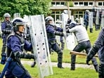 Police officers take part in a public order training session in preparation for COP26 in Glasgow on August 30. About 10,000 officers from around the UK will be deployed each day of the summit, making it one of the largest policing operations ever undertaken in Britain. AFP/FILE