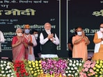 The Ayushman Bharat Health Infrastructure Mission will strengthen the health infrastructure of Uttar Pradesh as well as of the country, help in preparations to face future pandemics and bring confidence and self-reliance in the health sector, PM Modi said. Uttar Pradesh Governor Anandiben Patel, Union Minister for Health and Family Welfare, Chemicals and Fertilizers Mansukh Mandaviya, Chief Minister Yogi Adityanath, and other dignitaries are also seen in this photo.(ANI)
