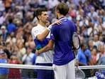 Novak Djokovic, of Serbia, left, congratulates Daniil Medvedev, of Russia(AP)