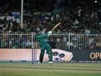 Pakistan's Asif Ali hits a six during the Cricket Twenty20 World Cup match between New Zealand and Pakistan in Sharjah, UAE, Tuesday, Oct. 26, 2021. (AP Photo/Aijaz Rahi)(AP)