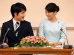 Princess Mako, the elder daughter of Prince Akishino and Princess Kiko, and her fiancee Kei Komuro, a university friend of Princess Mako, smile during a press conference to announce their engagement at Akasaka East Residence in Tokyo, Japan, September 3, 2017.(File Photo / REUTERS)