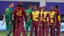 West Indies players, right, congratulate South Africa's Rassie van der Dussen, left, and Aiden Markram following their Twenty20 World Cup in Dubai.(AP)